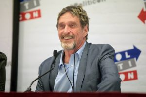 McAfee Says His Bitcoin Debit Card's Coming Soon. Can We Believe Him?