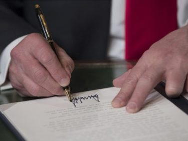 Donald Trump Signs Coronavirus Relief Bill with Over $100 Billion in Aid
