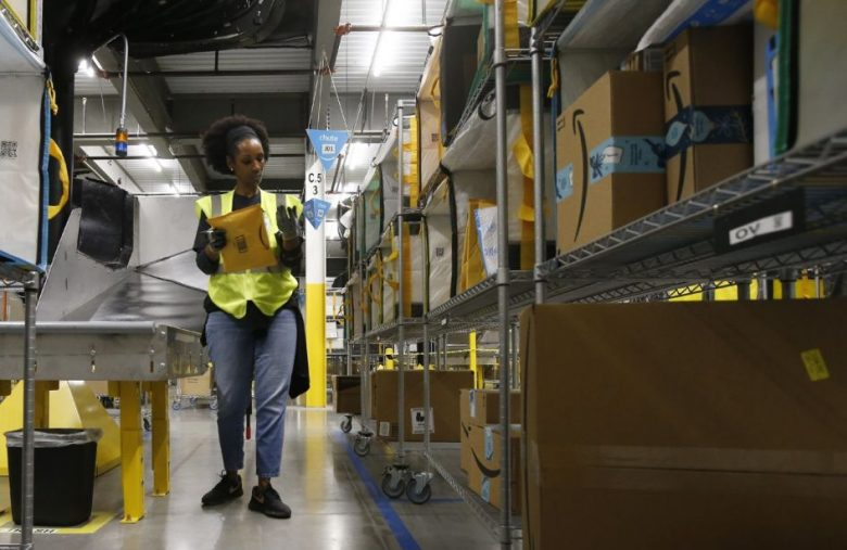 Amazon temporarily raises overtime pay for warehouse workers
