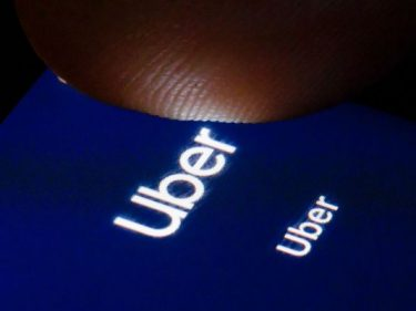 Uber pulls back from operating profit target