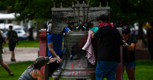 American Volunteers Erase Rioters' Graffiti, Damage