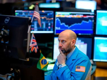 Dow Stumbles as Wall Street Debates the Case for Negative Rates