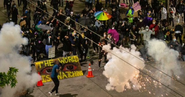 Man Allegedly Drives into Crowd, Shoots Protester