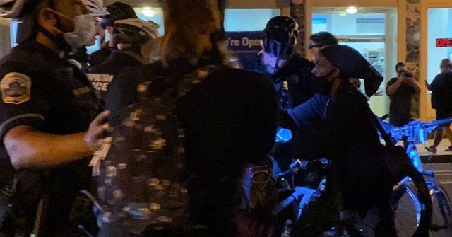 Hundreds of Protesters Take to the Streets in D.C., Scuffle with Police